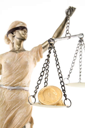 Justice blindfolded with money on a scale