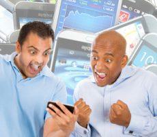 Two guys glued to their mobile phone / Zwei Männer begeistert von ihrem Handy
