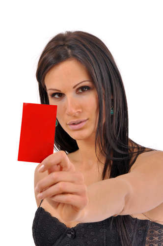 Sexy brunette showing red card