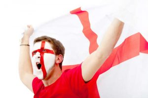 English football fan with face painted in the colours of the English flag