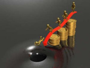Business picture about analysis - gold coins with people on a sliding slope