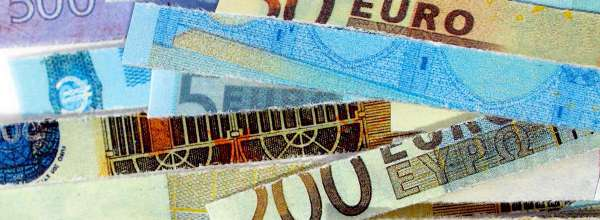Euro banknotes cut with a paper shredder