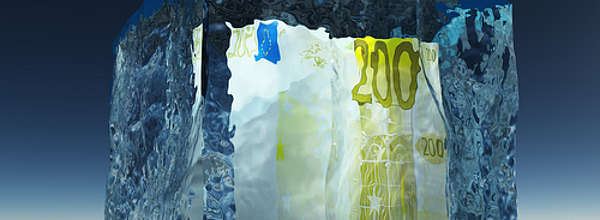 Frozen 200 Euro note in a block of ice