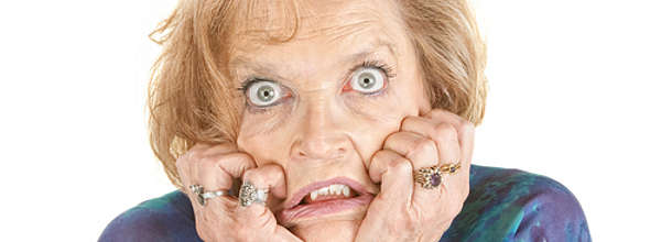 Intimidated older female with wide eyes
