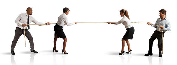 Tug of war between office workers - 4 people pulling on a rope