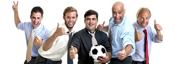 Team of happy businessmen cheering and embracing a soccer ball