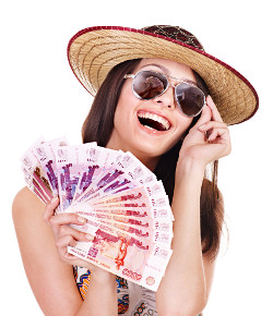 Attractive brunette with sunglasses fanning herself with a wad of bank notes
