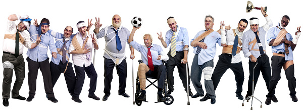 Soccer team of injured businessmen after a tough game