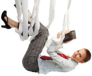 Suspended business woman clutching calculator