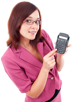 Smart smiling business woman with a calculator
